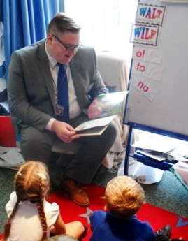 Me reading to children at Whitecotes Primary School as part of their reading week.