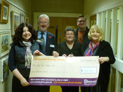 Glossopdale County Councillors Dave Wilcox, Ellie Wilcox and Damien Greenhalgh hand over their cheque to Chair of HPWA, Linda Rundle and Service Manager, Pam Whittle.